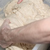 Hand on dough for the wonderful Tartine bread recipe