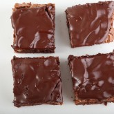 Add glazing after brownies are completely cooled
