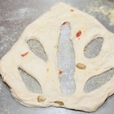 Cutting the fougasse dough