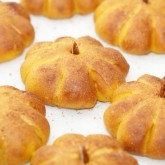 Baked pumpkin buns with pecan stems