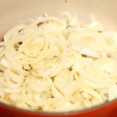 Frying sweet onions for the quiche filling