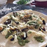 Pizza with grilled aubergines, mozzarella, parmesan and jalapeño pesto