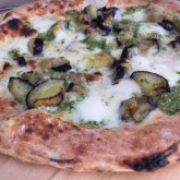 Pizza with grilled aubergines, mozzarella, parmesan and jalapeño pesto