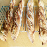 Nick Turner - Ficelles - I've now tried both baguette recipes a few times with varying success, but your Ficelle recipe is one I keep coming back too again and again. The timings work just great for for nice fresh loaves for dinner time, plus the four shaped loaves fit neatly on to the baking stone in my domestic oven. I usually just use 100% bread flour and they turn out vey baguette like with a beautifully crisp crust and light crumb. The batch in the picture however were made using an 100% Organic Stoneground Flour, I upped the hydration a bit too, lovely results which were demolished in minutes by family with cheese and wine!