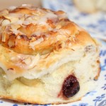 Cherry and almond cream buns with vanilla glaze
