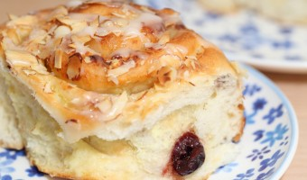 Cherry and almond cream buns with vanilla glaze